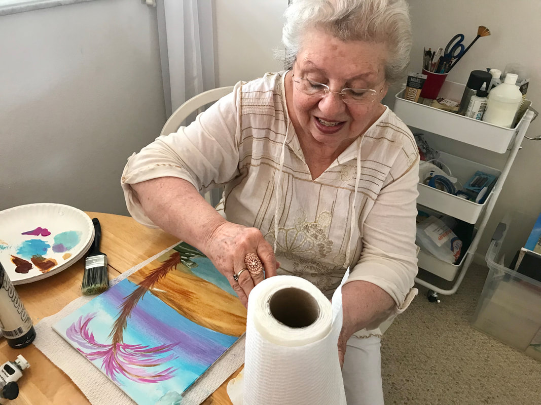 Jenny Leigh Hodgins' mother, Minva G. Hodgins, casually creating a watercolor scene.