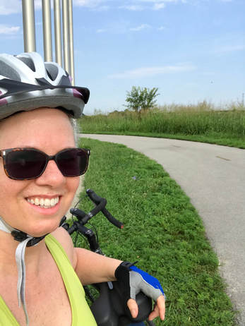 Jenny Leigh Hodgins cycling in honor of her brother, John Everett Hodgins.