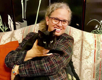 Creativeeprenuer Jenny Leigh Hodgins with black cat, Cory